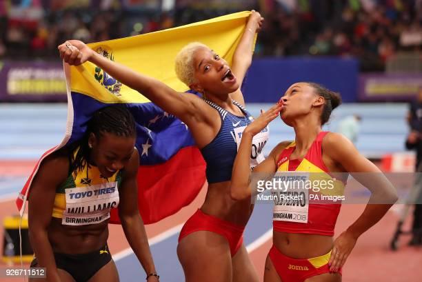 Venezuela's Yulimar Rojas celebrates winning the Women's Triple Jump with Spain's Ana Peleteiro and Jamaica's Kimberly Williams during day three of...