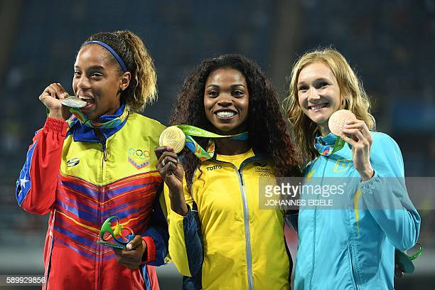 Venezuela's Yulimar Rojas Colombia's Caterine Ibarguen and Kazakhstan's Olga Rypakova pose during the podium ceremony for the women's Triple Jump...