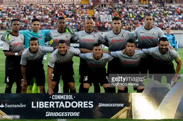 Venezuela's Zamora football team players pose before their Copa Libertadores football match against Brazil's Gremio at the Carolina stadium in...
