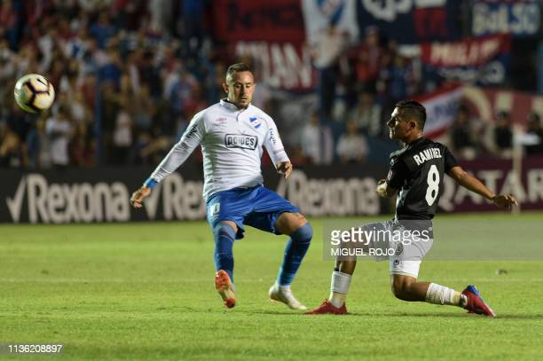 Venezuela's Zamora midfielder Pedro Antonio Ramirez and Uruguay's Nacional midfielder Rodrigo Amaral vie for the ballduring their 2019 Copa...
