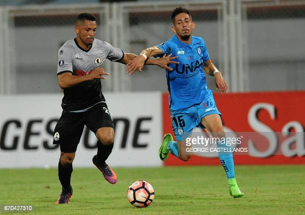 Venezuela's Zamora player Angel Faria vies for the ball with Felipe Reynero Galarce of Chile's Deportes Iquique during their Copa Libertadores...
