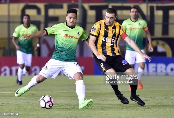 Venezuela's Zamora player Jose Pinto vies for the ball with Paraguay's Guarani player Marcelo Palau during their Copa Libertadores 2017 football...