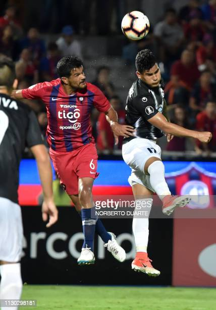 Venezuela's Zamora player Mayker Gonzalez jumps for a header with Paraguay's Cerro Porteno player Salustiano Candia during a Copa Libertadores...
