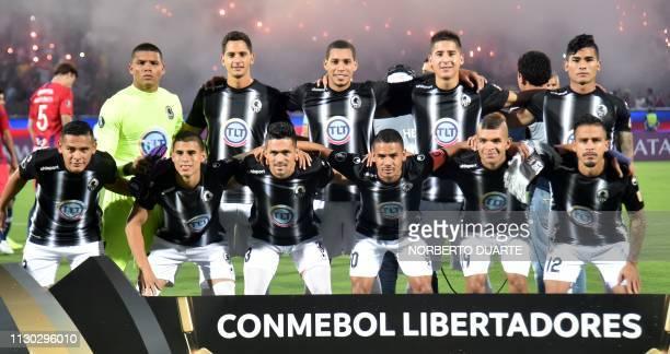 Venezuela's Zamora players pose before a Copa Libertadores football match against Paraguay's Cerro Porteno at Pablo Rojas Stadium in Asuncion on...