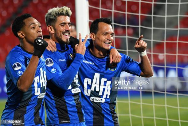 Venezuela's Zulia Evelio Hernandez celebrates with teammates Frank Feltscher and Jose Martinez after scoring a penalty against Chile's Palestino...