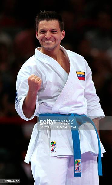 Venezuelian Antonio Diaz celebrates after winning the final of Male individual kata event at the Karate world championships on November 24 2012 in...