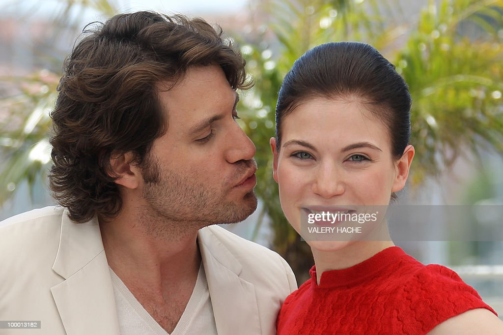 Venezuelian born actor Edgar Ramirez kisses Austrian actress Nora Von Waldstatten as they pose during the photocall of 'Carlos' presented out of competition at the 63rd Cannes Film Festival on May 20, 2010 in Cannes.