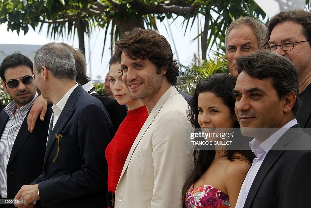 Venezuelian born actor Edgar Ramirez (C) poses with the cast during the photocall of 'Carlos' presented out of competition at the 63rd Cannes Film Festival on May 20, 2010 in Cannes.