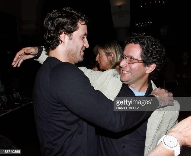 Venezuelian film director Alberto Arvelo is congratulated by Venezuelian actor Edgar Ramirez on September 29 2008 a the end of the projection of...