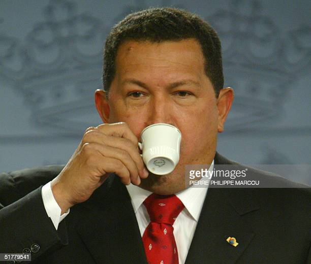 Venezuelian President Hugo Chavez drinks a coffee during his joined news conference with Spanish Prime Minister Jose Luis Rodriguez Zapatero in...
