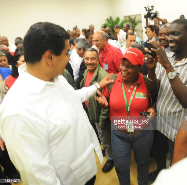 Venezuelian President Nicolas Maduro greets wellwishers on June 25 2013 during his visit to the presidential palace in PortauPrince Haiti Venezuela's...