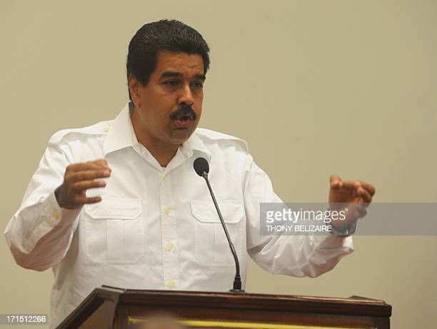 Venezuelian President Nicolas Maduro speaks on June 25 2013 at the presidential palace in PortauPrince Haiti Venezuela's President Nicolas Maduro...
