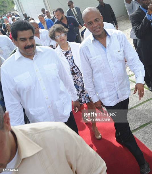 Venezuelian President Nicolas Maduro walks with Haitian president Michel Martelly on June 25 2013 during his visit to the presidential palace in...