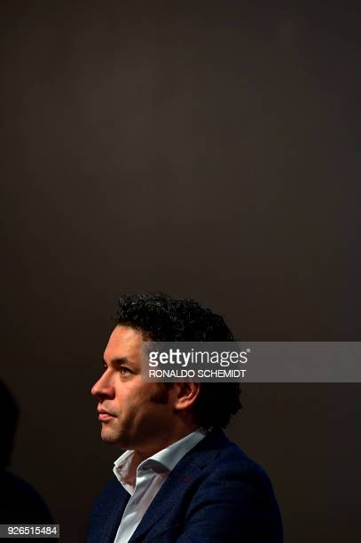 Venezulean conductor Gustavo Dudamel attends a press conference at the Fine Arts Palace in Mexico city on March 1 2018 Dudamel is in Mexico to...