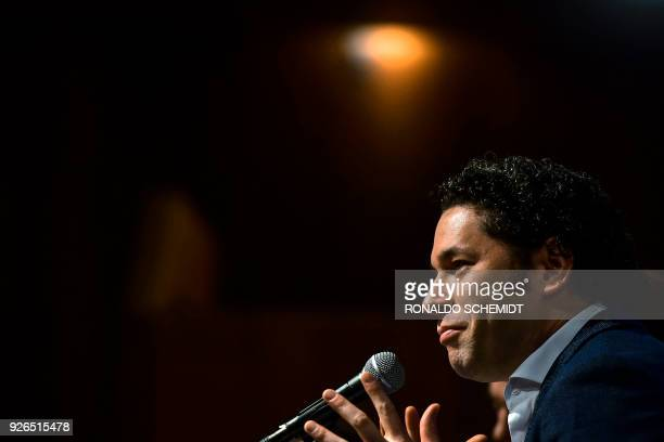 Venezulean conductor Gustavo Dudamel speaks during a press conference at the Fine Arts Palace in Mexico city on March 1 2018 Dudamel is in Mexico to...