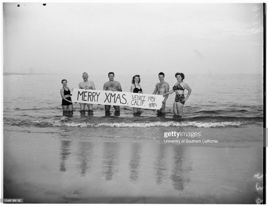 venice beach enthusiasts swim in ocean with merry christmas sign 1951 news - Merry Christmas Beach