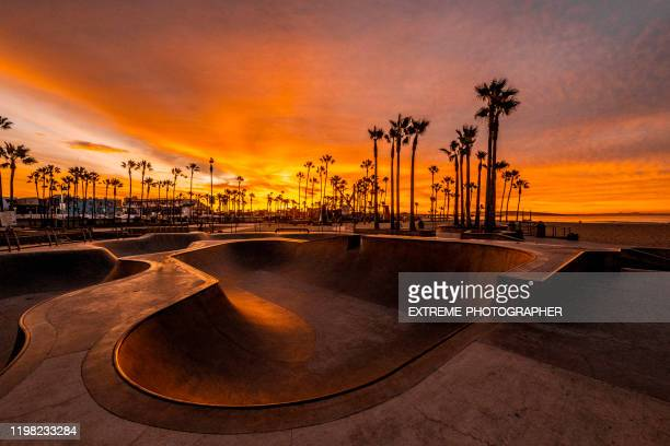 venice beach skate park shot at golden hour, los angeles, california - golden hour stock pictures, royalty-free photos & images