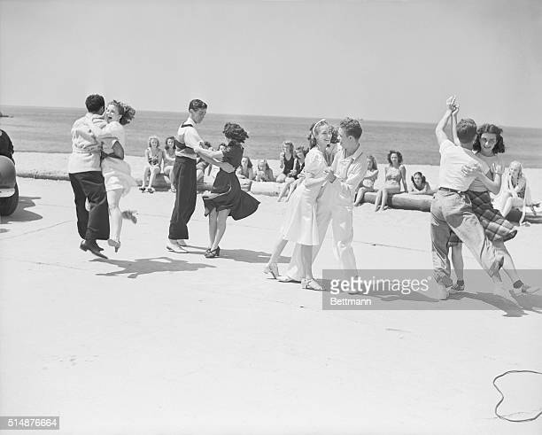 Swinging in the sandtimeon the sandy beach of Venice CA the jitterbugs have foregathered to put on one of the world's greatest swing jamborees Some...