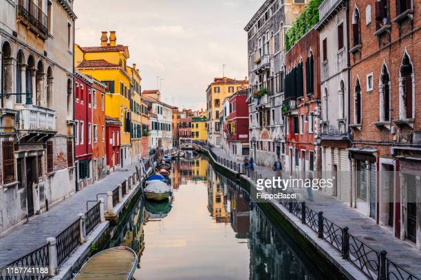venice canal view during sunset - venice stock pictures, royalty-free photos & images