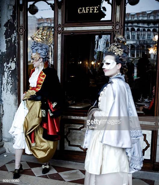 Venice Carnival. Elegant women in rokoko costumes.