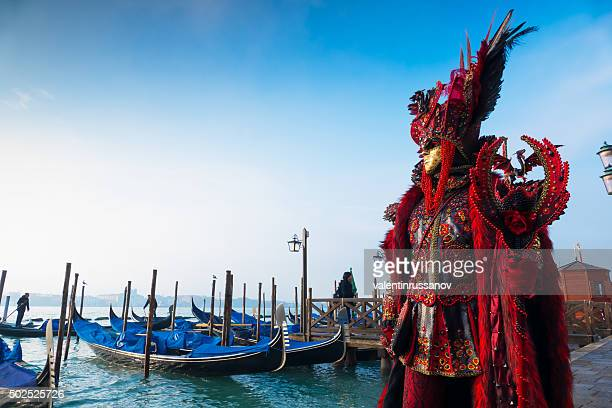 Venice Carnival in front of gondolas dock