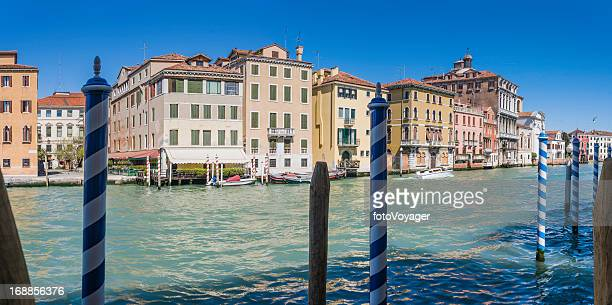 Venice colourful villas and stripy poles on Grand Canal Italy