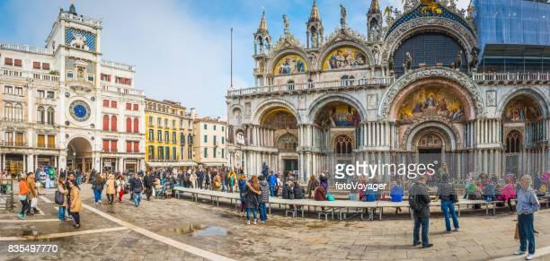 venice crowds of tourists in st marks square basilica italy - basilica di san marco foto e immagini stock