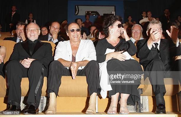 Venice Film Festival Director Marco Mueller director Adriano Celentano and Claudia Mori attend the Yuppi Du film premiere at the Sala Grande during...