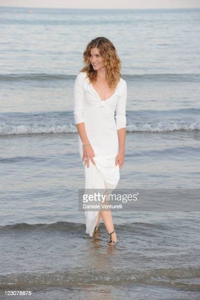 Venice Film Festival host Vittoria Puccini poses at a photocall during the 68th Venice International Film Festival on August 30, 2011 in Venice,...