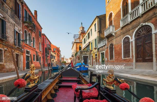 venice from the perspective of a gondola - gondola traditional boat stock pictures, royalty-free photos & images