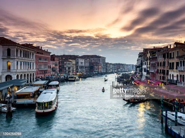 venice gran canal with gondole and vaporetto view from rialto bridge. - vaporetto stock-fotos und bilder