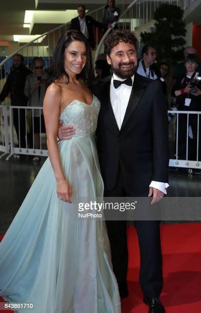 Giglia Marra and Federico Zampaglione walks the red carpet ahead of the 'Mektoub My Love Canto Uno' screening during the 74th Venice Film Festival