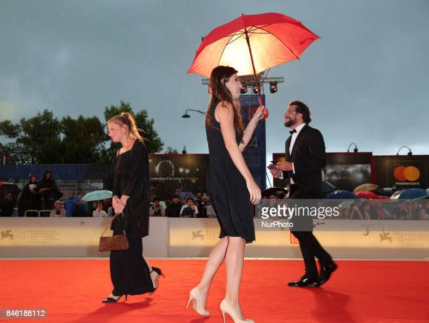 Guests walks the red carpet ahead of the 'Mektoub My Love Canto Uno' screening during the 74th Venice Film Festival