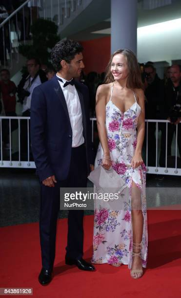 Salim Kechiouche and Lou Luttiau walks the red carpet ahead of the 'Mektoub My Love Canto Uno' screening during the 74th Venice Film Festival