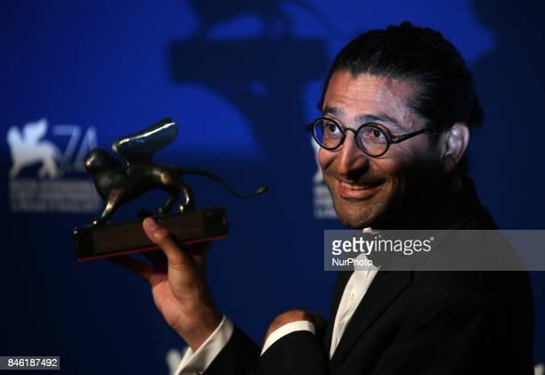 Venice Italy 09 September 2017 Alireza Khatam poses with the Orizzonti Award for Best Screenplay Award for 'Los Versos Del Olvido' at the Award...