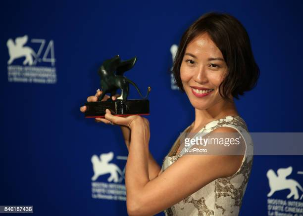Venice Italy 09 September 2017 Gina Kim poses with the Best VR Experience Award for 'La Camera Insabbiata' codirected with Laurie Anderson at the...