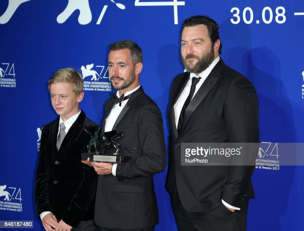 Venice Italy 09 September 2017 Thomas Gioria Xavier Legrand and Denis Menochet pose with the Silver Lion for Best Director Award for 'Jusqu' la...