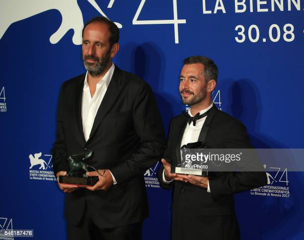 Venice Italy 09 September 2017 Xavier Legrand and Alexandre Gavras pose with the Silver Lion for Best Director Award for 'Jusqu' la Garde' and the...