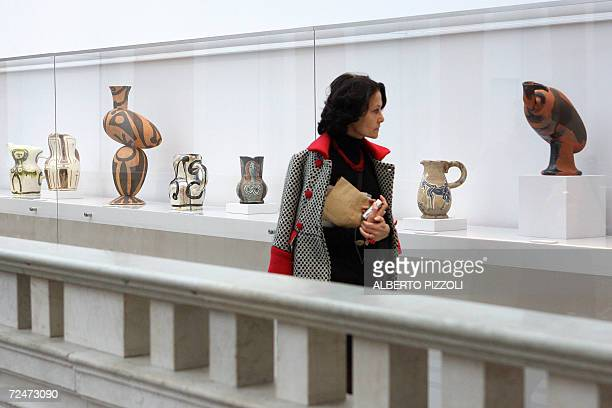 A visitor looks at Picasso potteries on display at the Picasso la joie de vivre 19451948 exhibition at the Palazzo Grassi in Venice 09 November 2006...