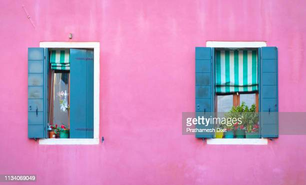 venice italy - beautiful pink wall with two blue windows - veneto stock pictures, royalty-free photos & images