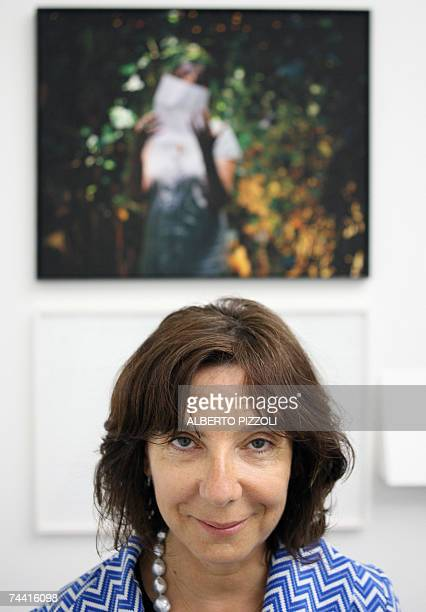French artist Sophie Calle poses in front of one of her works that will be exhibited in the Venice contemporary art Bienniale 06 June 2007 The 52nd...