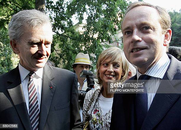 French Culture Minister Renaud Donnedieu de Vabre and French luxury goods group LVMH chief executive Bernard Arnault stand outside France Pavilion at...