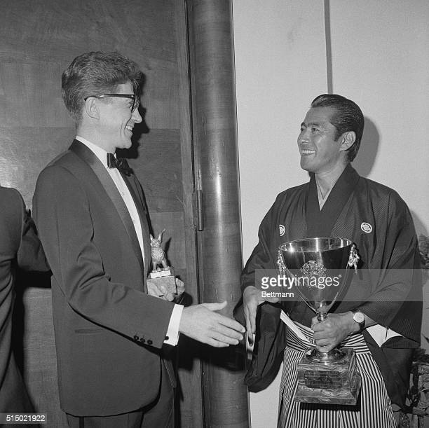 Venice Italy french film director Alain Resnais and Japanese actor Toshiro Mifune congratulate each other after winning top honors September 5th at...