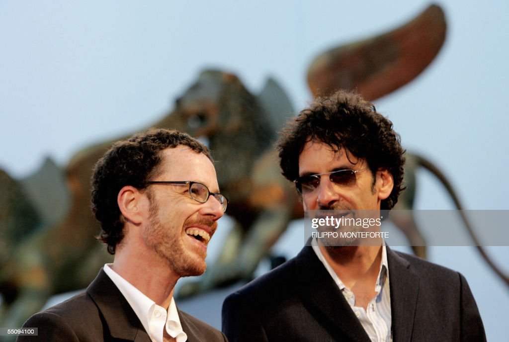 Joel (L) and Ethan Cohen stand posing for photographers at the premiere of their movie 'Romance and Cigarettes' in contest at the 62nd edition of Venice International Film Festival in Venice Lido 06 September 2005. AFP PHOTO / Filippo MONTEFORTE