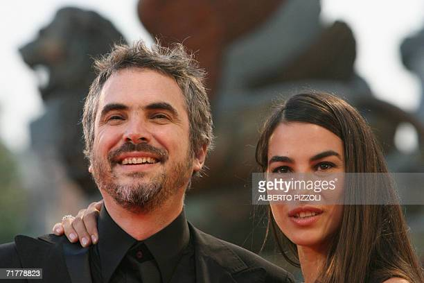 Mexican director Alfonso Cuaron next to his wife Annalisa arrives for the screening of his movie Children of Men at the Lido of Venice 03 September...