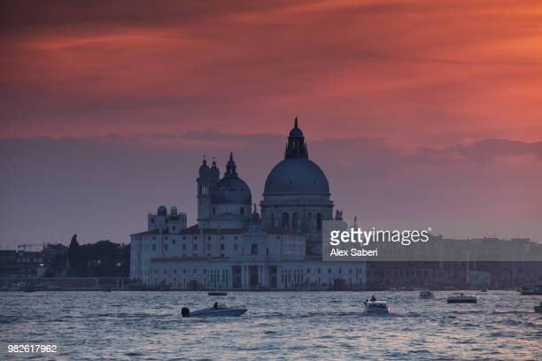 A dramatic sunset over the Roman catholic church, Santa Maria della Salute.