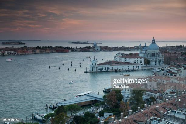 A colorful sunset over the Roman catholic church, Santa Maria della Salute with the Grand Canal.