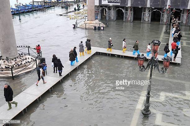 floods rising sea Rise in the water level floods rise in the water level flood rising water levels aqua alta flood footbridge bridge ganway gateway...