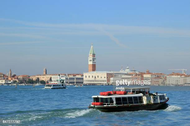 Venice on : vaporetto on St. Mark's Basin, with the Ducal Palace and St Mark's Campanile in the background
