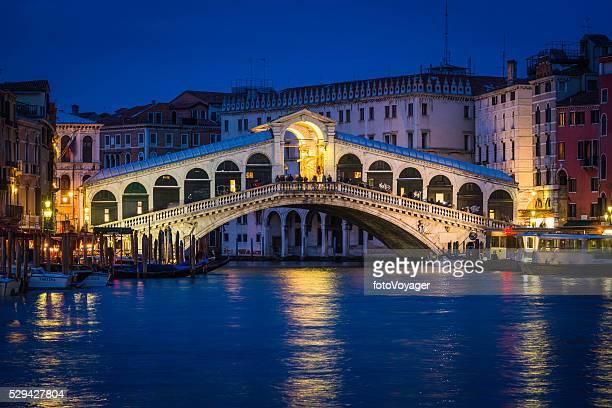 Venice Rialto Bridge and Grand Canal palazzo illuminated night Italy